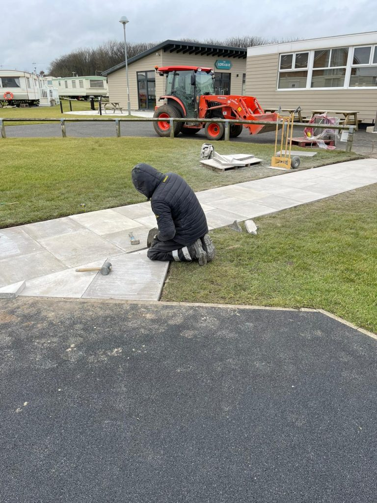 Busy behind the scenes laying a footpath to the play park at Northumberland Caravan Park Golden Sands in Cresswell Northumberland